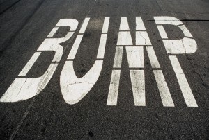 'Bump' written on a tarmac road