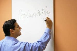 Businessman writing on a whiteboard
